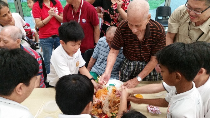 Traditional Lo-Hei session to celebrate the festival